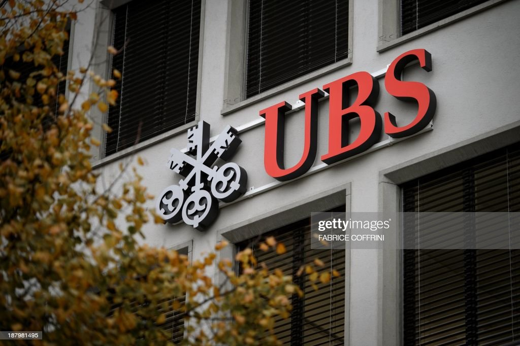 A logo of Swiss banking giant UBS is seen on a building on November 14, 2013 in Zurich.