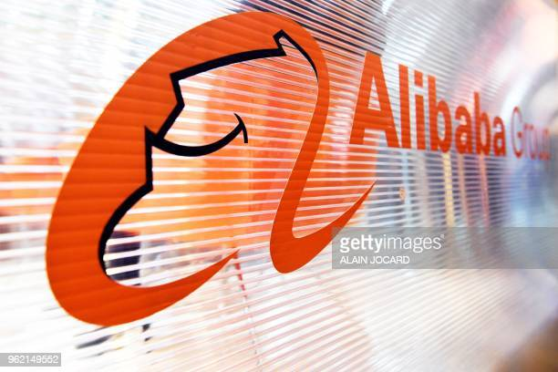 A logo of the Chinese multinational ecommerce retail internet and technology conglomerate Alibaba group is pictured on a window of a stand during the...
