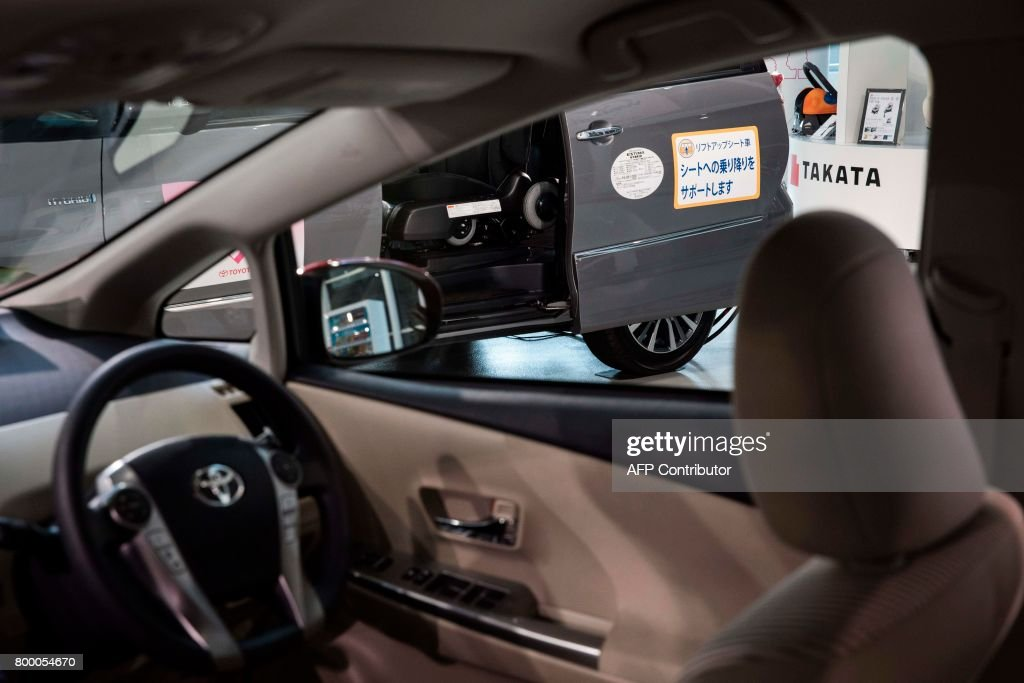 Logo Of The Japanese Auto Parts Maker Takata Is Seen From Inside A