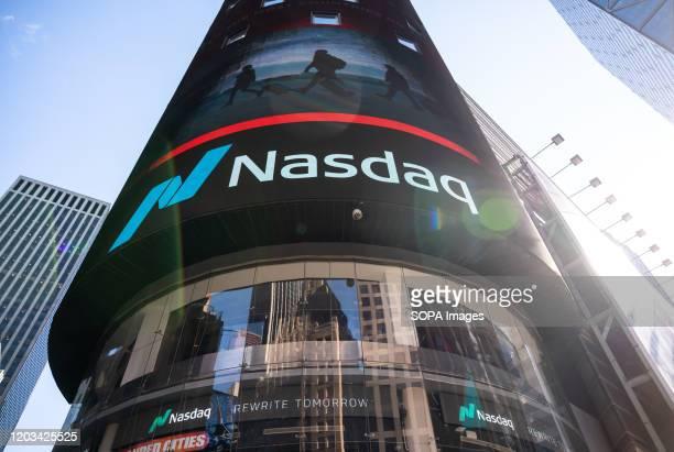 A logo of the Nasdaq Stock Market seen in Midtown Manhattan