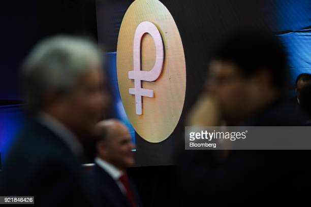 Logo of the new Venezuelan cryptocurrency Petro is seen during the launch event in Caracas Venezuela on Tuesday Feb 20 2018 Maduro launched Petro to...