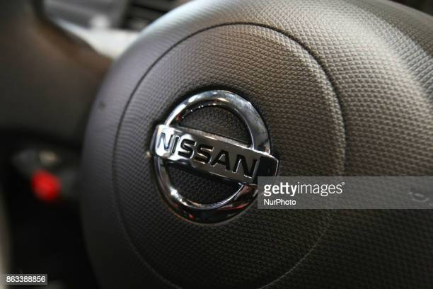 Logo of the Nissan Motor Co is displayed in Tokyo Japan October 19 2017 Nissan dips 2% after suspending production in Japan