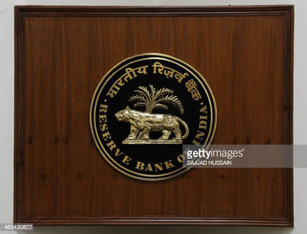 A logo of The Reserve Bank of India is pictured in New Delhi on August 10 2014 AFP PHOTO/ SAJJAD HUSSAIN