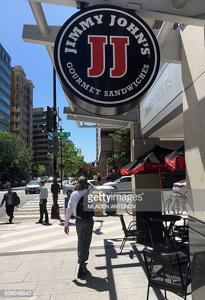 A logo of the sandwich restaurant chain specializing in delivery Jimmy John's hangs outside one of their shops in downtown Washington DC June 9 2016...