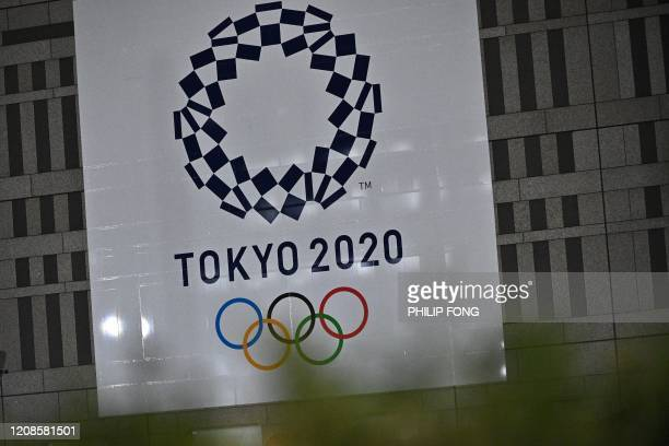 A logo of the Tokyo 2020 Olympic Games is seen at the Metropolitan government building in Tokyo on March 30 2020 Postponed Tokyo Olympics to open...