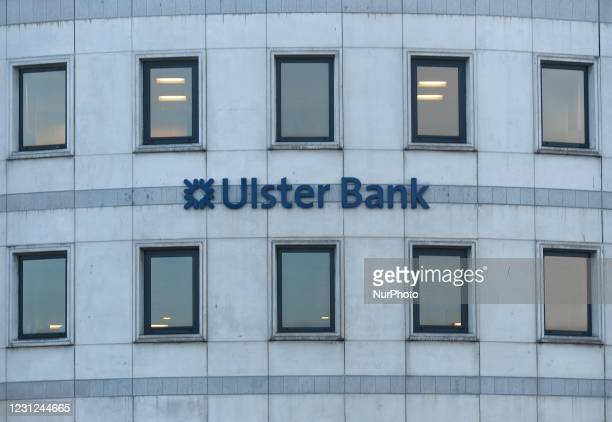 Logo of the Ulster Bank seen on a facade of the Ulster Bank Capital Markets bulding, on Georges Quay in Dublin city center. People seen outside the...