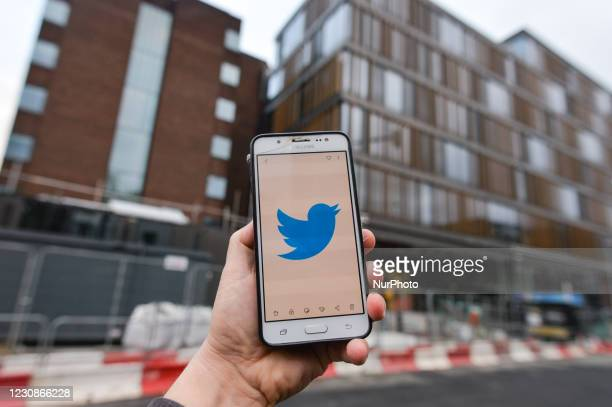 Logo of Twitter displayed on a mobile phone in front of Twitter new European Headquarters in Dublin. On Friday, 29 January in Dublin, Ireland.