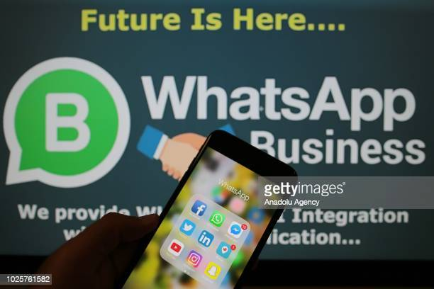 Logo of WhatsApp application is seen in front of a screen reading WhatApp Business in Ankara Turkey on September 1 2018