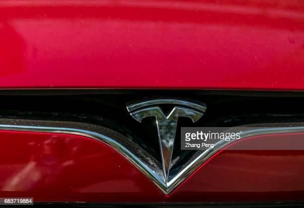 Logo on a Tesla car According to the recent financial report of Tesla the total revenue in the first quarter of this year amounts to $2696 billion...