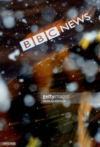A BBC logo on an umbrella is seen in a little snow storm outside the BBC building at Portland Place after the release of the Hutton report led to the...