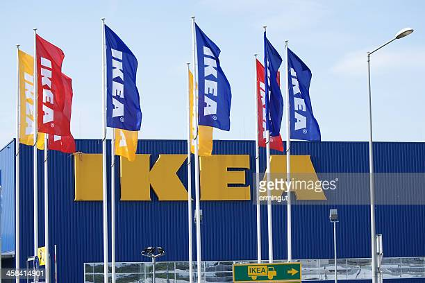 IKEA logo on building behind flags