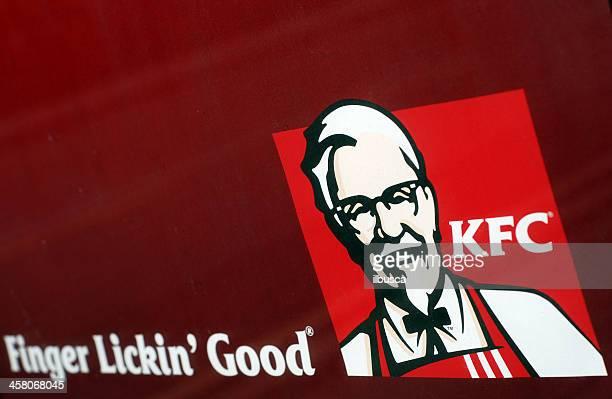 kfc (kentucky fried chicken) logo on street billboard - kentucky fried chicken stock photos and pictures