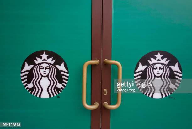 Logo on the door of a 'Coming soon' Starbucks coffee shop According to the secondquarter financial report of Starbucks issued at the end of April...