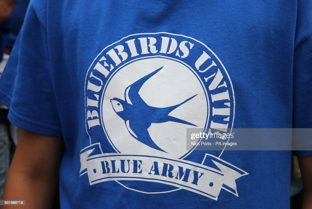 Logo on the t-shirt of a Cardiff City fan during the Bluebirds Unite protest against the clubs change of shirt colour from blue to red