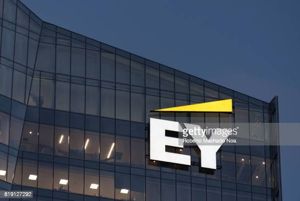 EY logo or sign in modern downtown skyscraper EY is a global leader in assurance tax transaction and advisory services