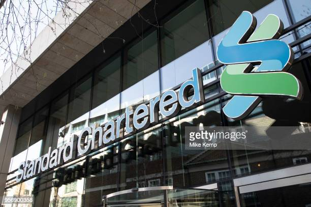 Logo sign for Standard Chartered Bank in London England United Kingdom Standard Chartered PLC is a multinational financial services company...