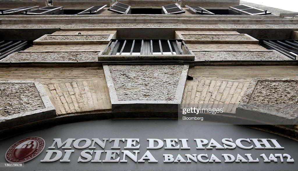 A Logo Sits Above A Banca Monte Dei Paschi Di Siena Spa Branch In