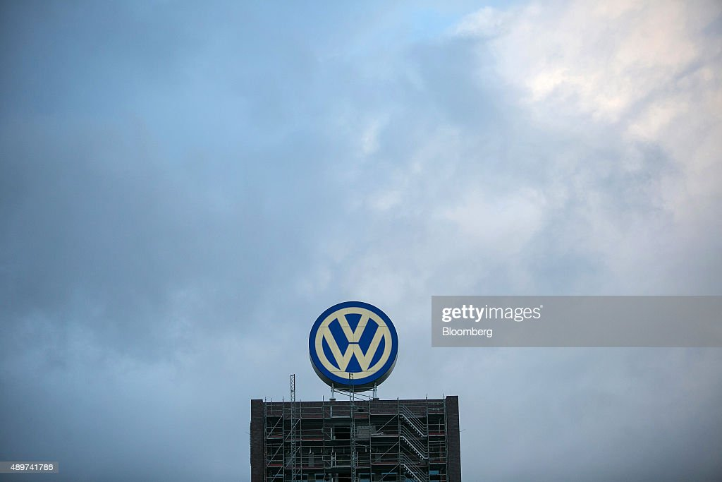 A VW logo sits above a building under construction at the Volkswagen AG headquarters in Wolfsburg, Germany, on Wednesday, Sept. 23, 2015. Volkswagen's escalating scandal over emissions-test cheating is beginning to ripple across the $10 trillion global corporate bond market. Photographer: Krisztian Bocsi/Bloomberg via Getty Images