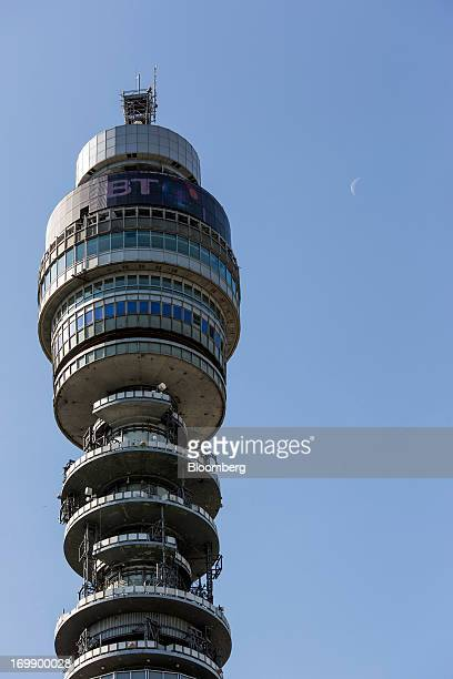 A BT logo sits above communications equipment on the BT Tower in London UK on Monday June 3 2013 BT Group Plc the UK's largest fixedline company...