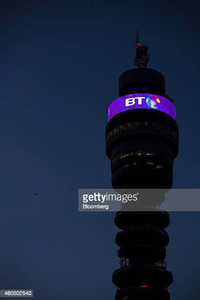 A BT logo sits above communications equipment on the BT Tower operated by BT Group Plc in London UK on Monday Dec 15 2014 BT started exclusive talks...