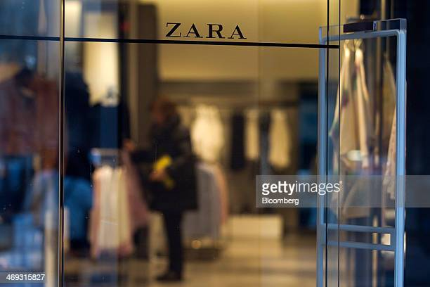 A logo sits above the doorway of the original Zara fashion store operated by Inditex SA which opened in 1975 in La Coruna Spain on Thursday Feb 13...
