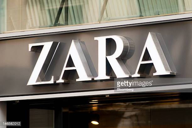 A logo sits above the entrance to a Zara fashion store operated by Inditex SA in Barcelona Spain on Tuesday June 19 2012 Spanish Prime Minister...