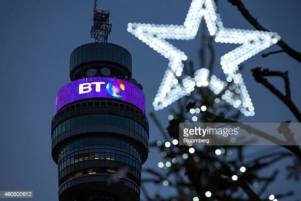 A BT logo sits behind Christmas street decorations on the BT Tower operated by BT Group Plc in London UK on Monday Dec 15 2014 BT started exclusive...