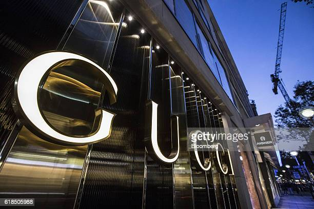 A logo sits illuminated on a Gucci luxury goods boutique operated by Kering SA in Frankfurt Germany on Wednesday Oct 26 2016 The world's luxurygoods...
