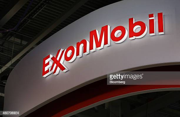 A logo sits illuminated outside the Exxon Mobil Corp corporate pavilion during the 21st World Petroleum Congress in Moscow Russia on Monday June 16...
