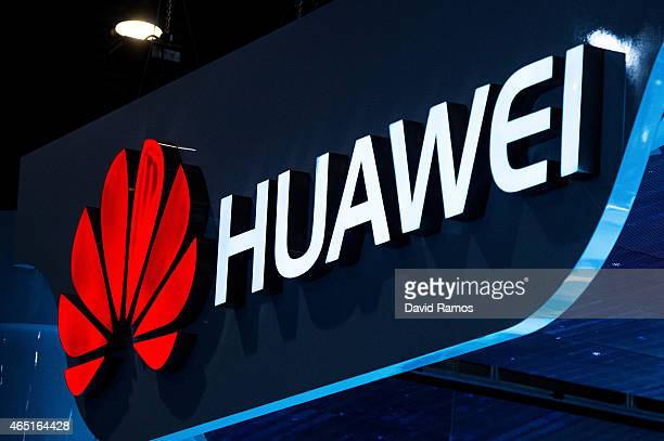 A logo sits illuminated outside the Huawei pavilion during the second day of the Mobile World Congress 2015 at the Fira Gran Via complex on March 3...