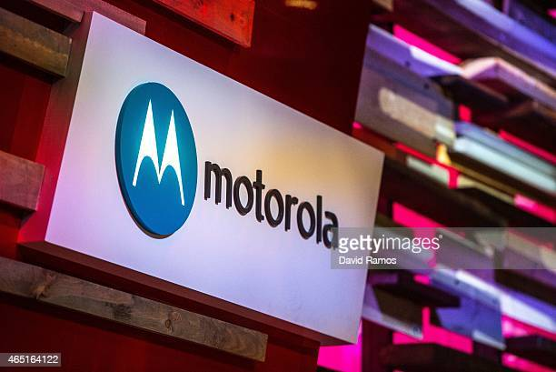 A logo sits illuminated outside the Motorola pavilion during the second day of the Mobile World Congress 2015 at the Fira Gran Via complex on March 3...