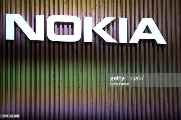 A logo sits illuminated outside the Nokia pavilion during the second day of the Mobile World Congress 2015 at the Fira Gran Via complex on March 3...