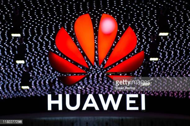 A logo sits illumintated outside the Huawei booth on day 2 of the GSMA Mobile World Congress 2019 on February 26 2019 in Barcelona Spain The annual...
