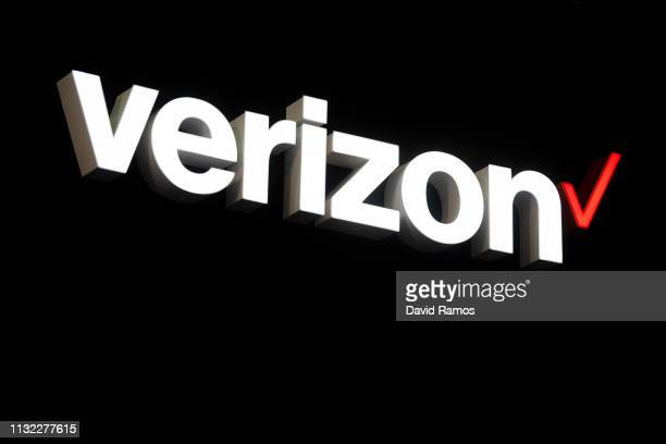 A logo sits illumintated outside the Verizon booth on day 2 of the GSMA Mobile World Congress 2019 on February 26 2019 in Barcelona Spain The annual...