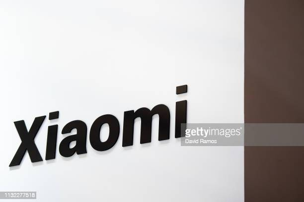 Logo sits illumintated outside the Xiaomi booth on day 2 of the GSMA Mobile World Congress 2019 on February 26, 2019 in Barcelona, Spain. The annual...