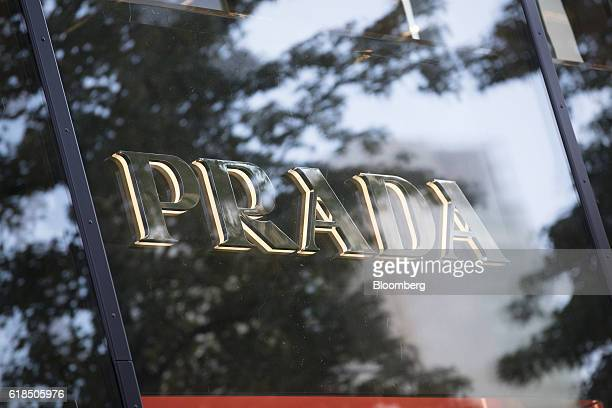 A logo sits in the window of a Prada SpA luxury goods boutique in Frankfurt Germany on Wednesday Oct 26 2016 The world's luxurygoods market stopped...