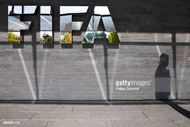 FIFA logo sits next to the entrance at the FIFA headquarters on September 25 2015 in Zurich Switzerland