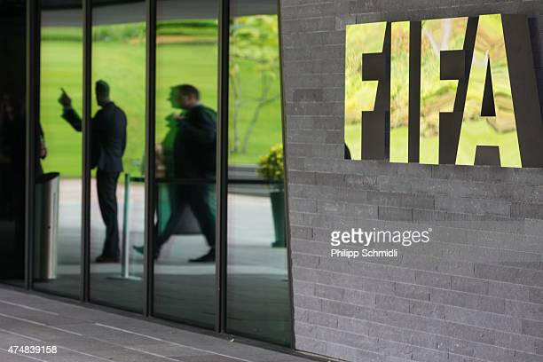 Logo sits next to the entrance to the FIFA headquarters on May 27, 2015 in Zurich, Switzerland. Swiss police on Wednesday raided a Zurich hotel to...