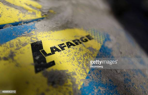 A logo sits on a bag of building cement manufactured by Lafarge SA inside a BQ home improvement store operated by Kingfisher Plc in Reading UK on...