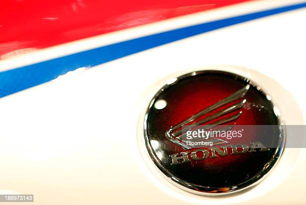 A logo sits on a Fireblade SP motorbike produced by Honda Motor Co as it stands on display at the International Motorcycle Exhibition in Milan Italy...