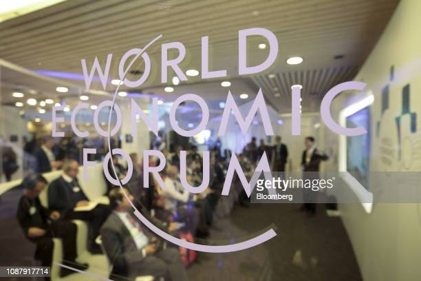 A WEF logo sits on a glass panel inside the Congress Center on day three of the World Economic Forum in Davos Switzerland on Thursday Jan 24 2019...