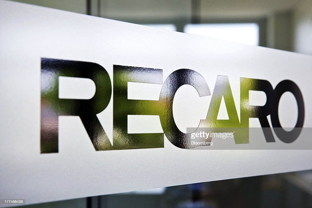 A logo sits on a glass wall inside Recaro Aircraft Seating GmbH & Co.'s assembly plant in Schwabish Hall, Germany, on Thursday, Aug. 22, 2013. Germany's economic growth in the second quarter was driven by consumption and a rebound in investment as a recovery in the 17-nation euro area, its biggest trading partner, bolstered confidence. Photographer: Gianluca Colla/Bloomberg via Getty Images