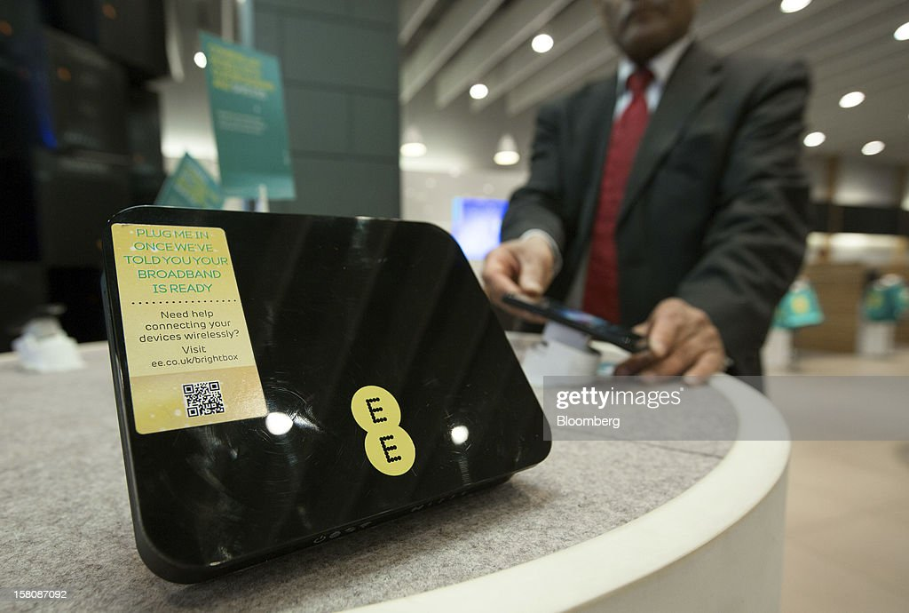 A logo sits on a home broadband router displayed inside a EE (Everything Everywhere) store, a joint venture between France Telecom SA and Deutsche Telekom AG, in Stratford, U.K., on Monday, Dec. 5, 2012. France Telecom CEO Stephane Richard said in an interview last month that the Paris-based company has received interest from private-equity firms seeking a minority stake in the 50-50 venture, and may also consider an initial public offering of the unit. Photographer: Jason Alden/Bloomberg via Getty Images