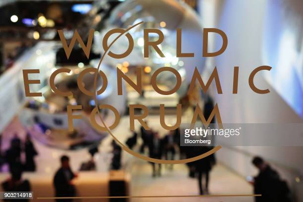 WEF logo sits on a pane of glass inside the Congress Center during the World Economic Forum in Davos Switzerland on Wednesday Jan 18 2017 President...