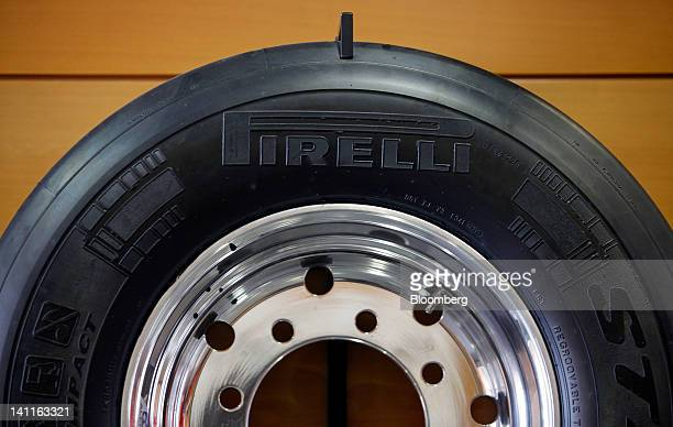 A logo sits on a Pirelli C SpA tire displayed inside the company's research and development facility in Milan Italy on Thursday March 8 2012 Rubber...