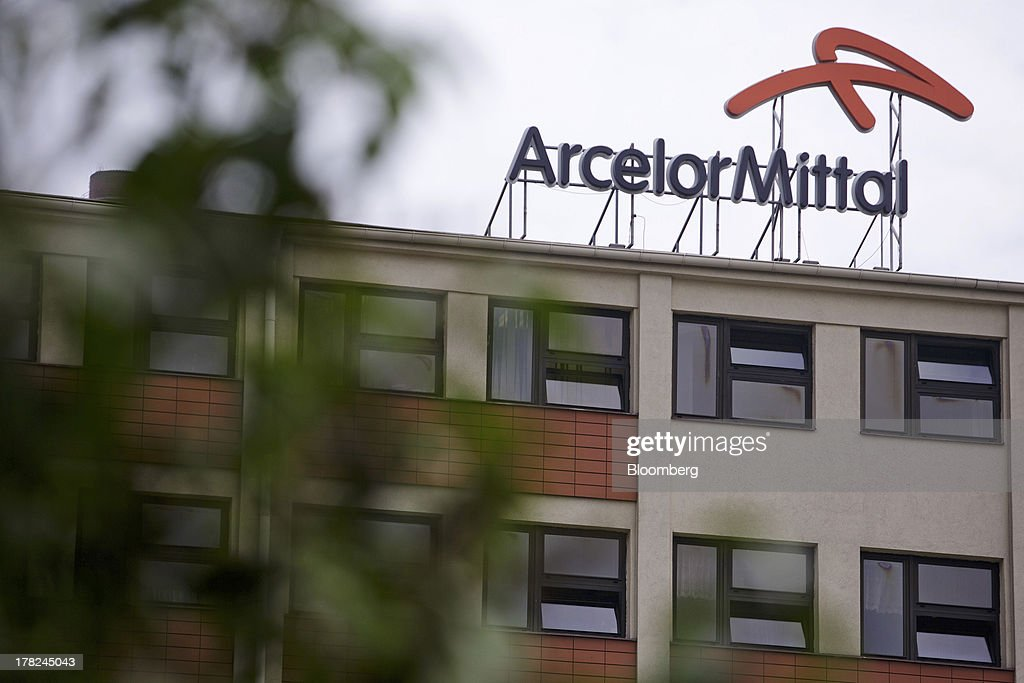 A logo sits on a rooftop above windows at ArcelorMittal's steel plant in Ostrava, Czech Republic, on Monday, Aug. 26, 2013. ArcelorMittal, the world's biggest steelmaker, said steel shipments will rise 1 percent to 2 percent this year compared with an earlier forecast of 2 percent in May. Photographer: Martin Divisek/Bloomberg via Getty Images