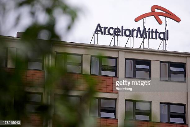 Logo sits on a rooftop above windows at ArcelorMittal's steel plant in Ostrava, Czech Republic, on Monday, Aug. 26, 2013. ArcelorMittal, the world's...