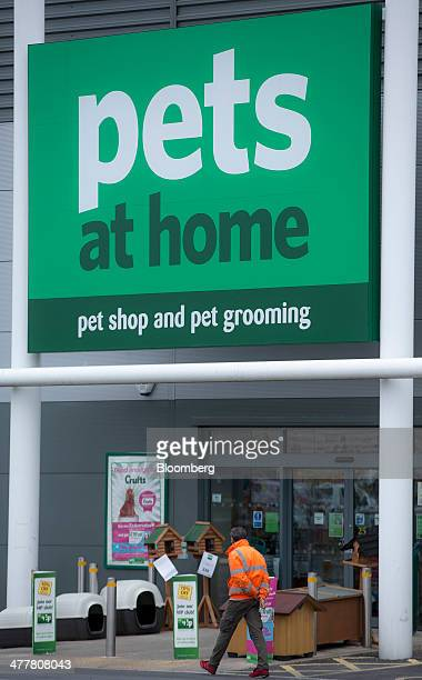 A logo sits on a sign above the entrance to a Pets at Home Ltd store in London UK on Monday March 10 2014 Pets at Home majorityowned by privateequity...
