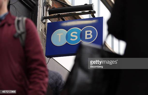 Logo sits on a sign as it hangs outside a TSB bank branch, operated by TSB Banking Group Plc, in London, U.K., on Friday, March 20, 2015. Banco de...