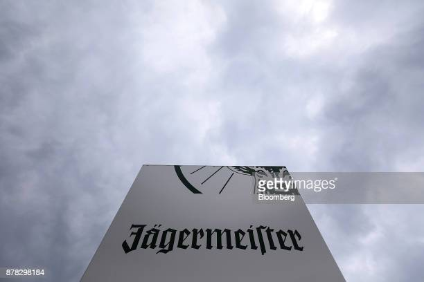 A logo sits on a sign near the MastJaegermeister SE fruit liquor bottling plant in WolfenbuettelLinden Germany on Wednesday Oct 11 2017 German...